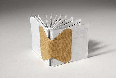 Simple book<br /> accordian fold with bandaid (or similar)